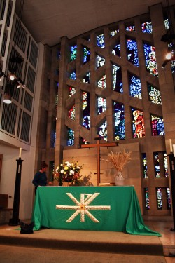 The church altar and Piper window at harvest